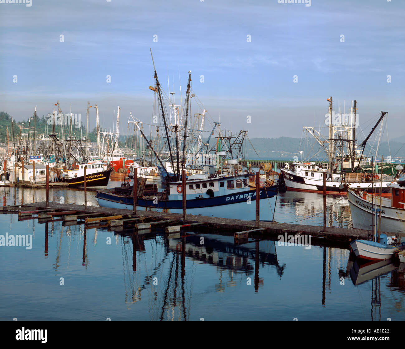 Newport oregon showing the calm harbor filled with for Newport harbor fishing
