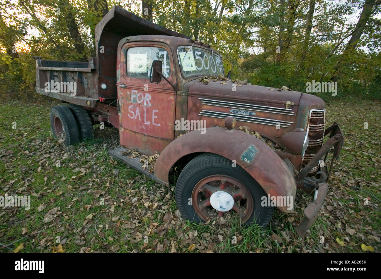 Old truck in autumn has For Sale sign in New England Stock Photo ...