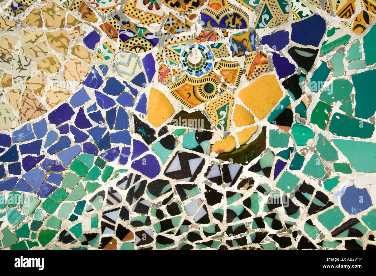 Closeup of mosaic of colored ceramic tile by antoni gaudi at his closeup of mosaic of colored ceramic tile by antoni gaudi at his parc guell barcelona spain doublecrazyfo Choice Image