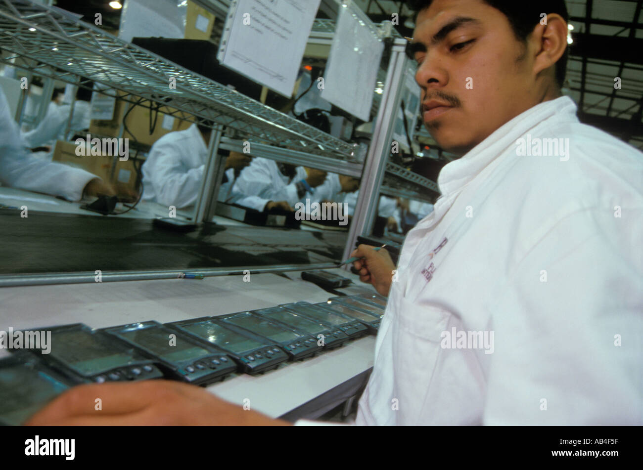 flextronics stock photos flextronics stock images alamy quality control check on the palm pilot assembly line at the flextronics plant in guadalajara jalisco