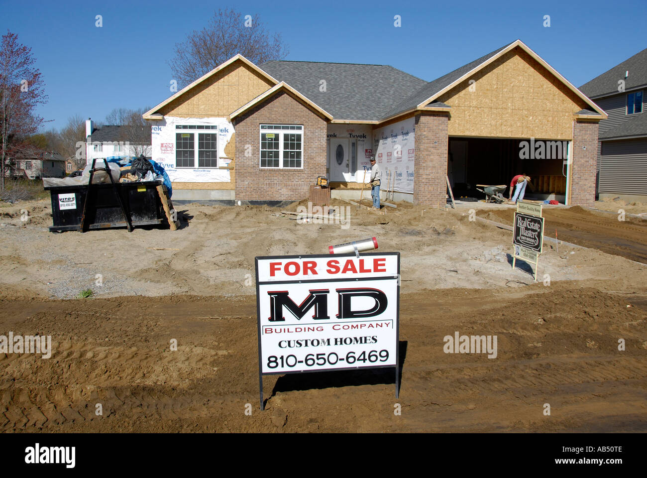 New home construction with builders sign in front of house for New home sign