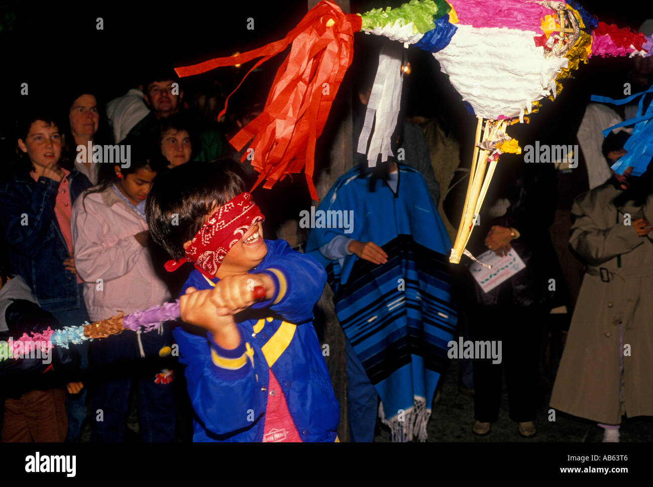 Mexican-American, boy, breaking pinata, Las Posadas, Christmas ...