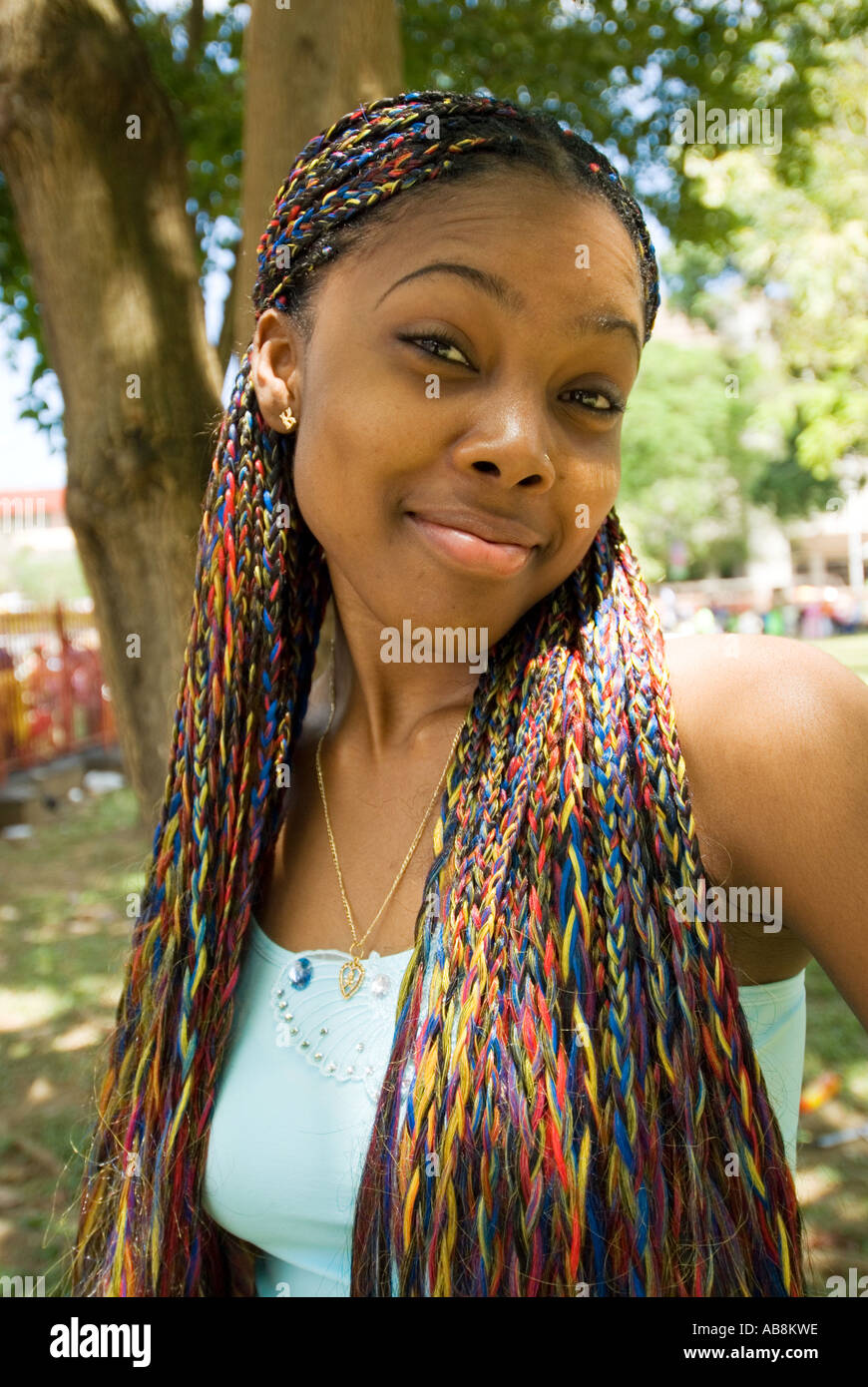 West Indies Trinidad Carnival Port Of Spain Portrait Young Lady With Colorful Braided Long Hair Posing For The Camera