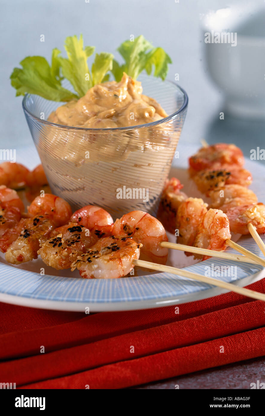 Prawn kebabs with cocktail sauce and celery garnish for Canape garnishes