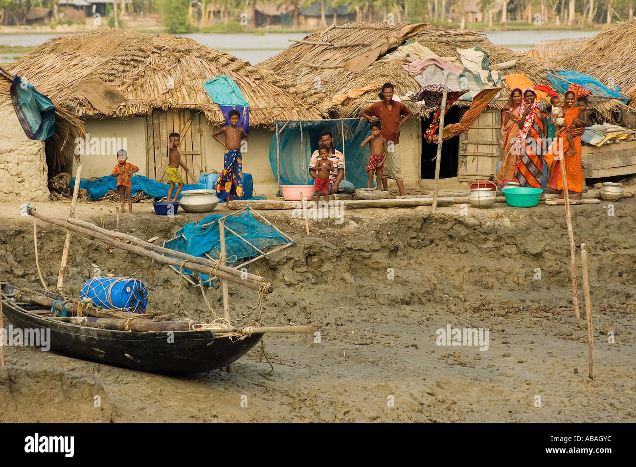 Poor fishing village and thatched roof mud houses along for Bangla house photo