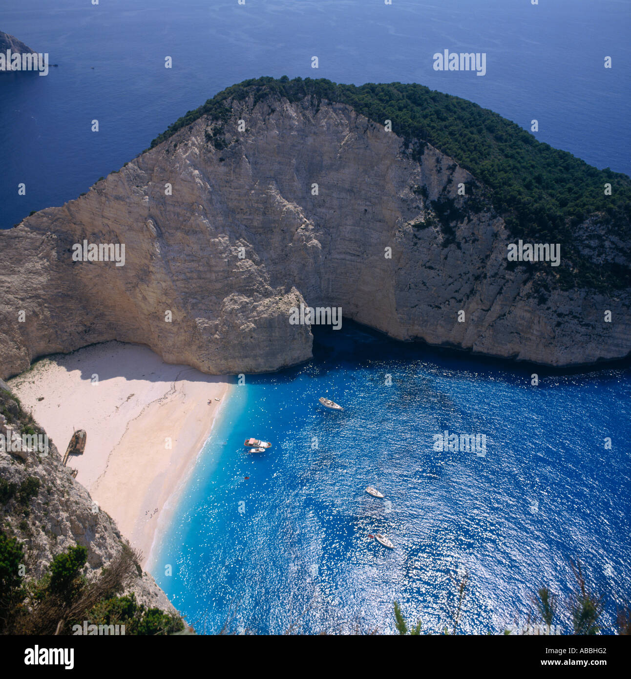 Classic white sand beach with high cliffs boats and deep ...