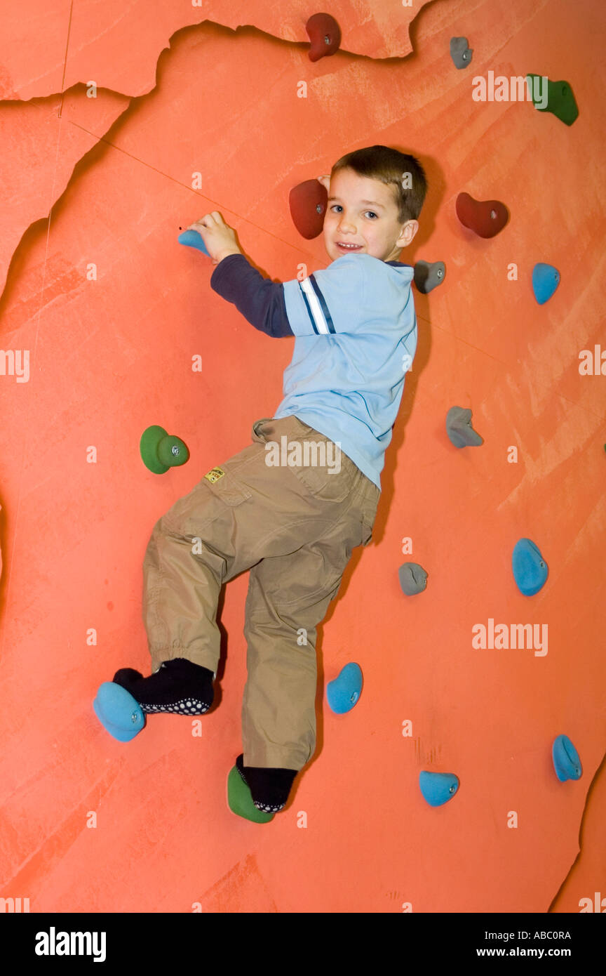 Children playing in an indoor playground at a climbing ...