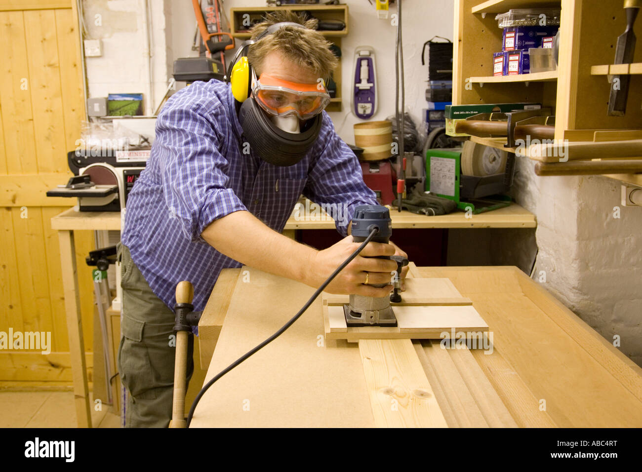 A Cabinet Maker Uses A Router With A Custom Made Jig To