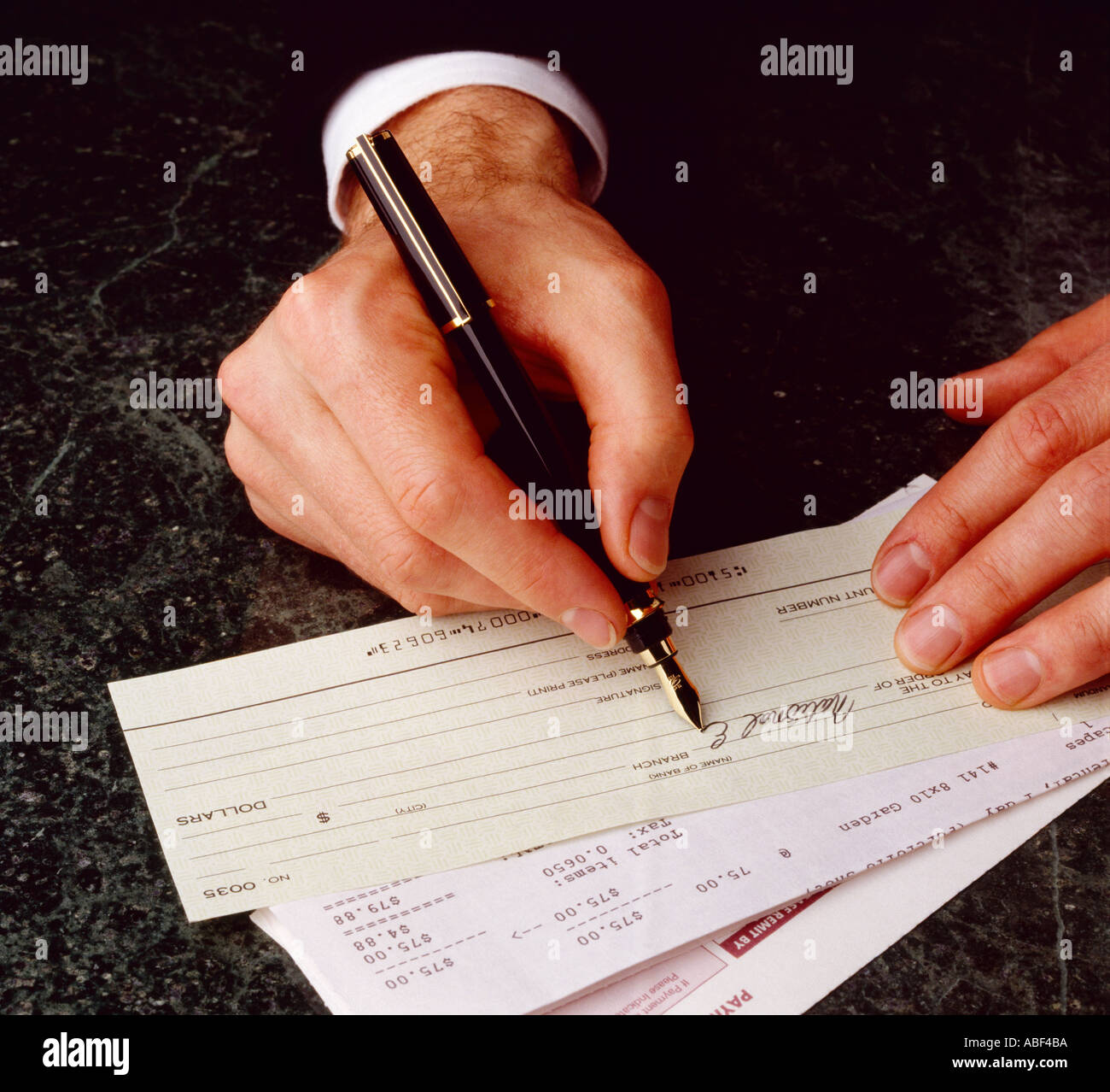Financial  Hands Of A Businessman Writing A Check  Stock Image