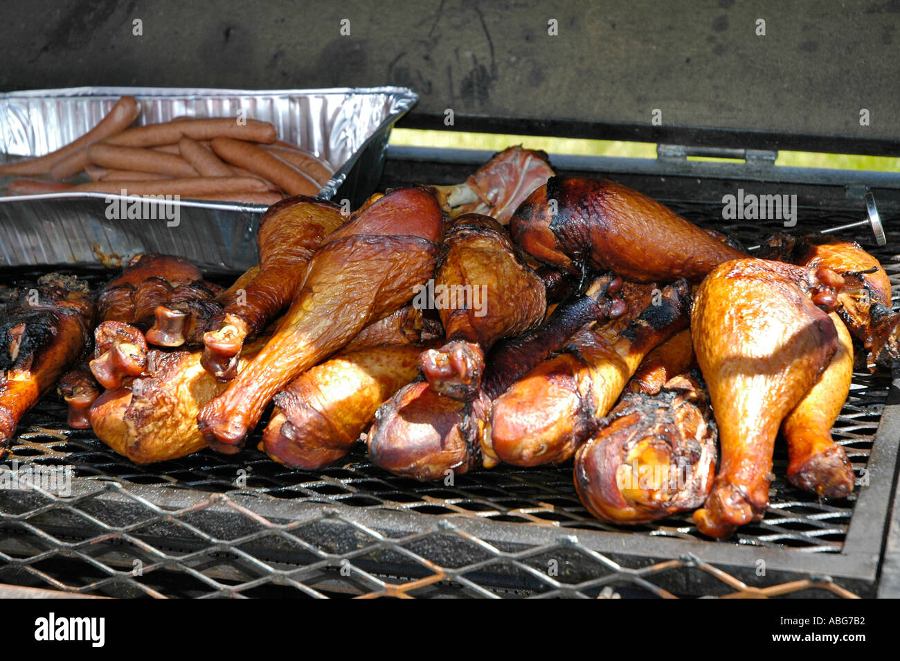 Turkey legs and hot dogs cooking on a hot grill Stock Photo ...