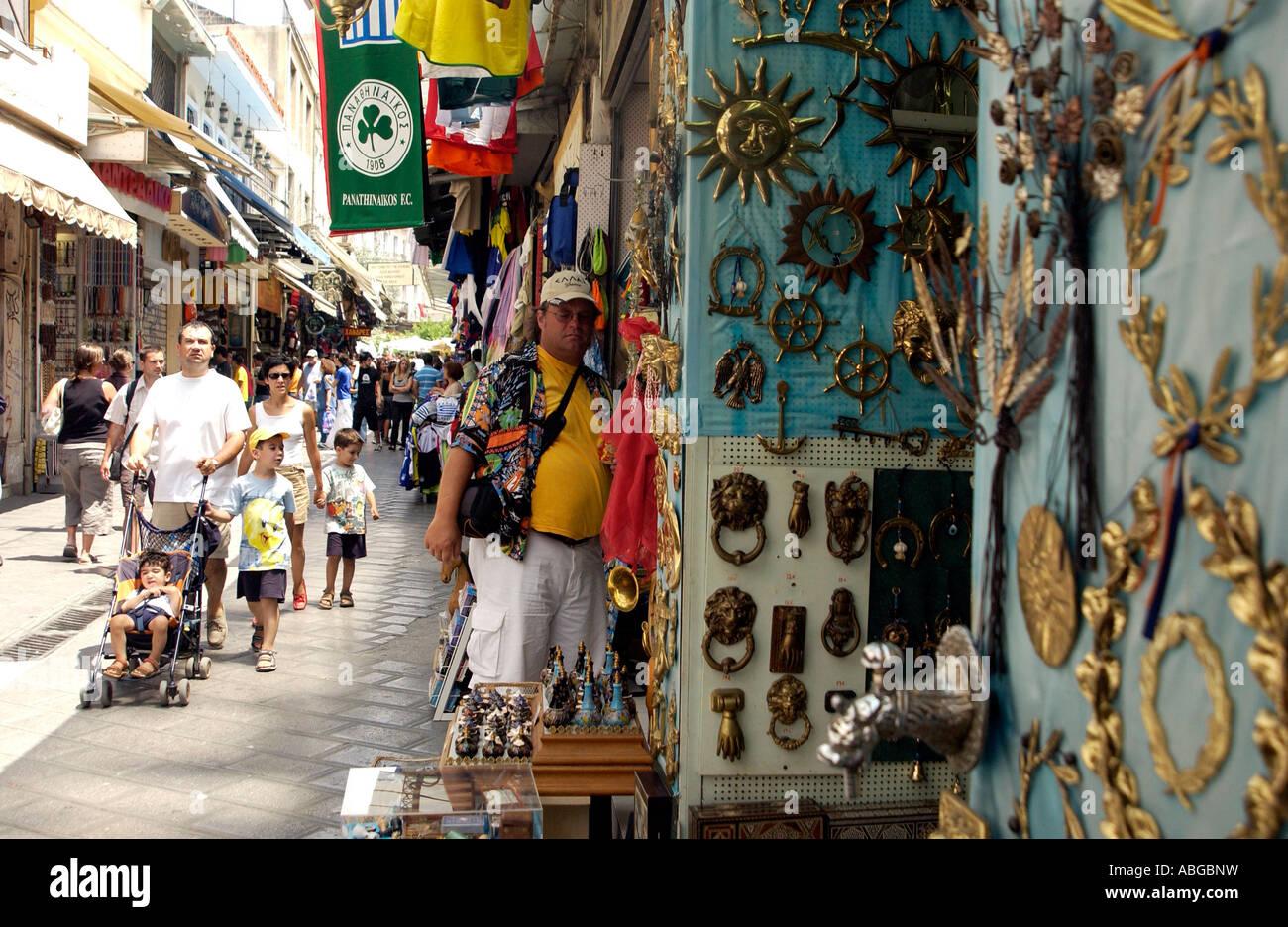 Tourists shop at the Monastiraki Flea market in the Plaka ...