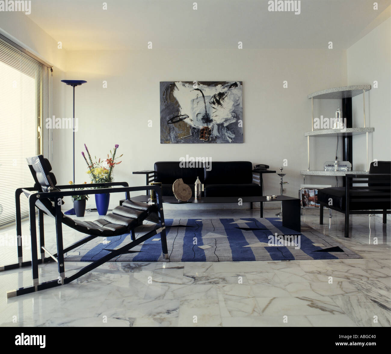 Striped Rug In Living Room Marble Floor And Black Reclining Chair In Modern White Sixties