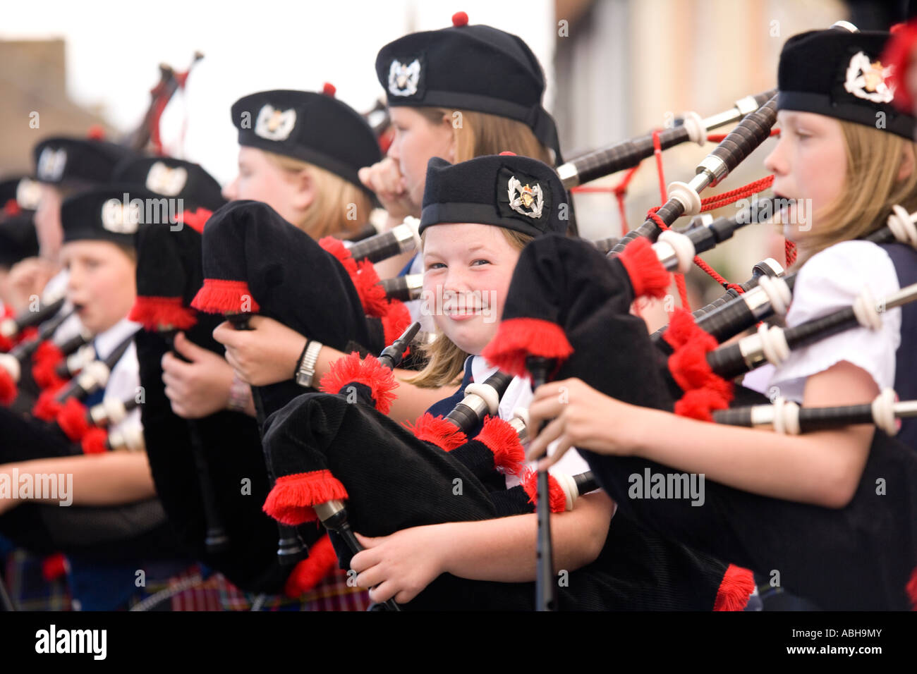 pipe band young kids playing the bagpipes on annan high street
