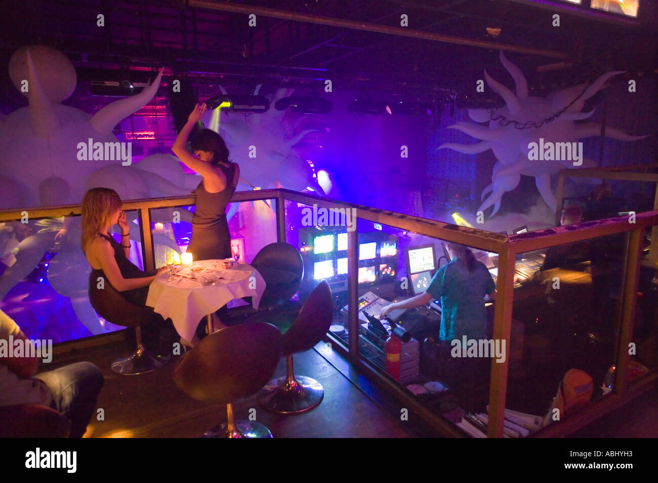 young woman dancing at table in escape a discotheque at. Black Bedroom Furniture Sets. Home Design Ideas