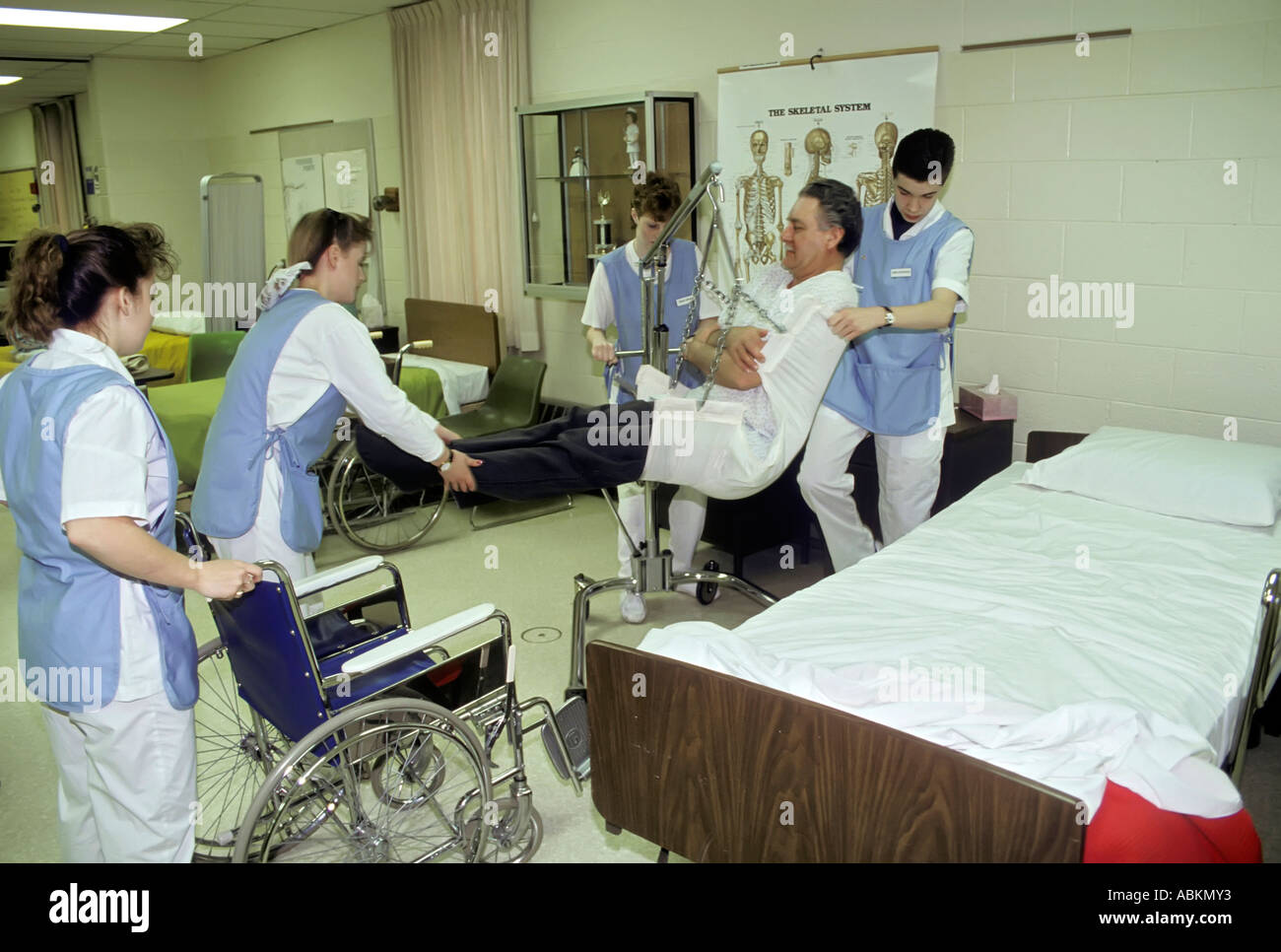 student nurses aids practice getting a patient our of bed and into