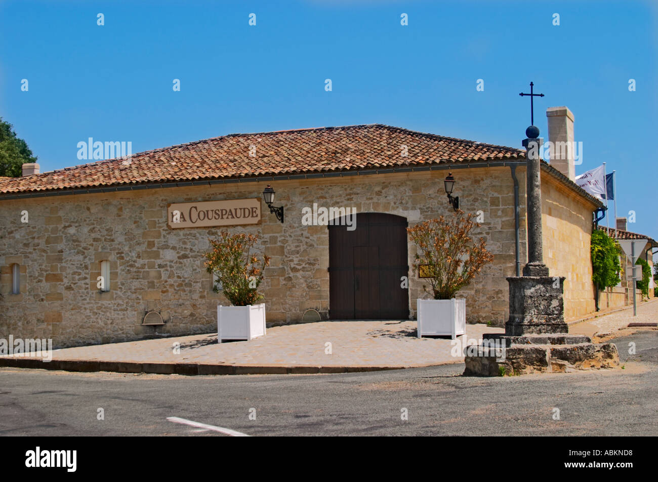 Chateau La Couspaude on a road crossing with a stone pillar and ...
