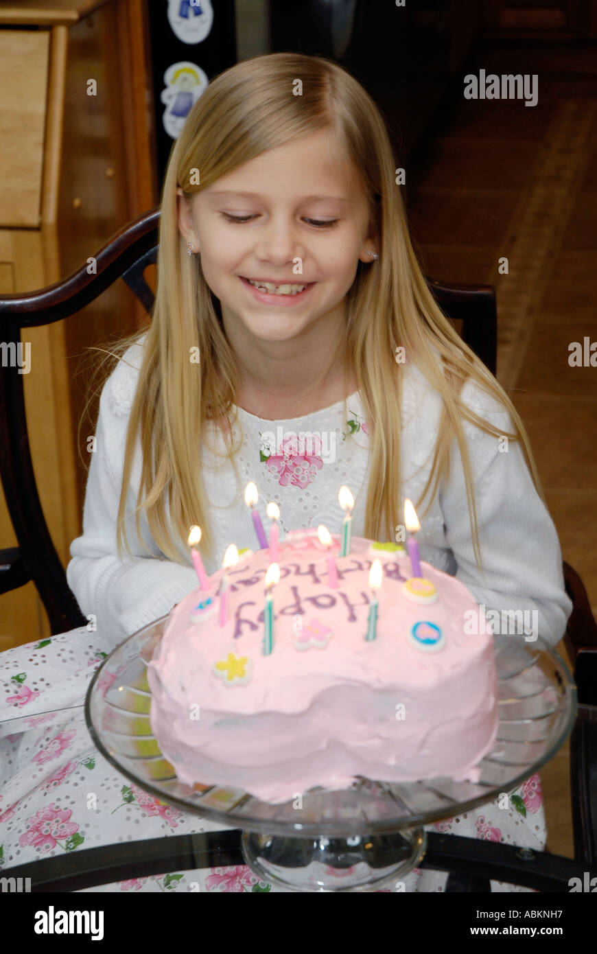 8 Year Old Girl Celebrates Her Birthday With A Cake With