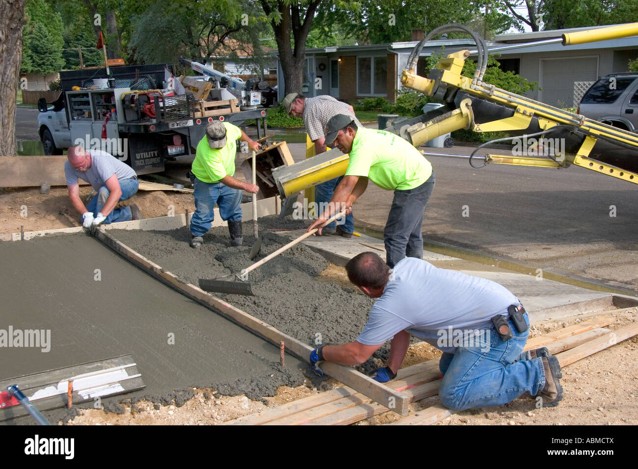 Workers pouring a new concrete driveway in boise idaho for Pouring concrete driveway