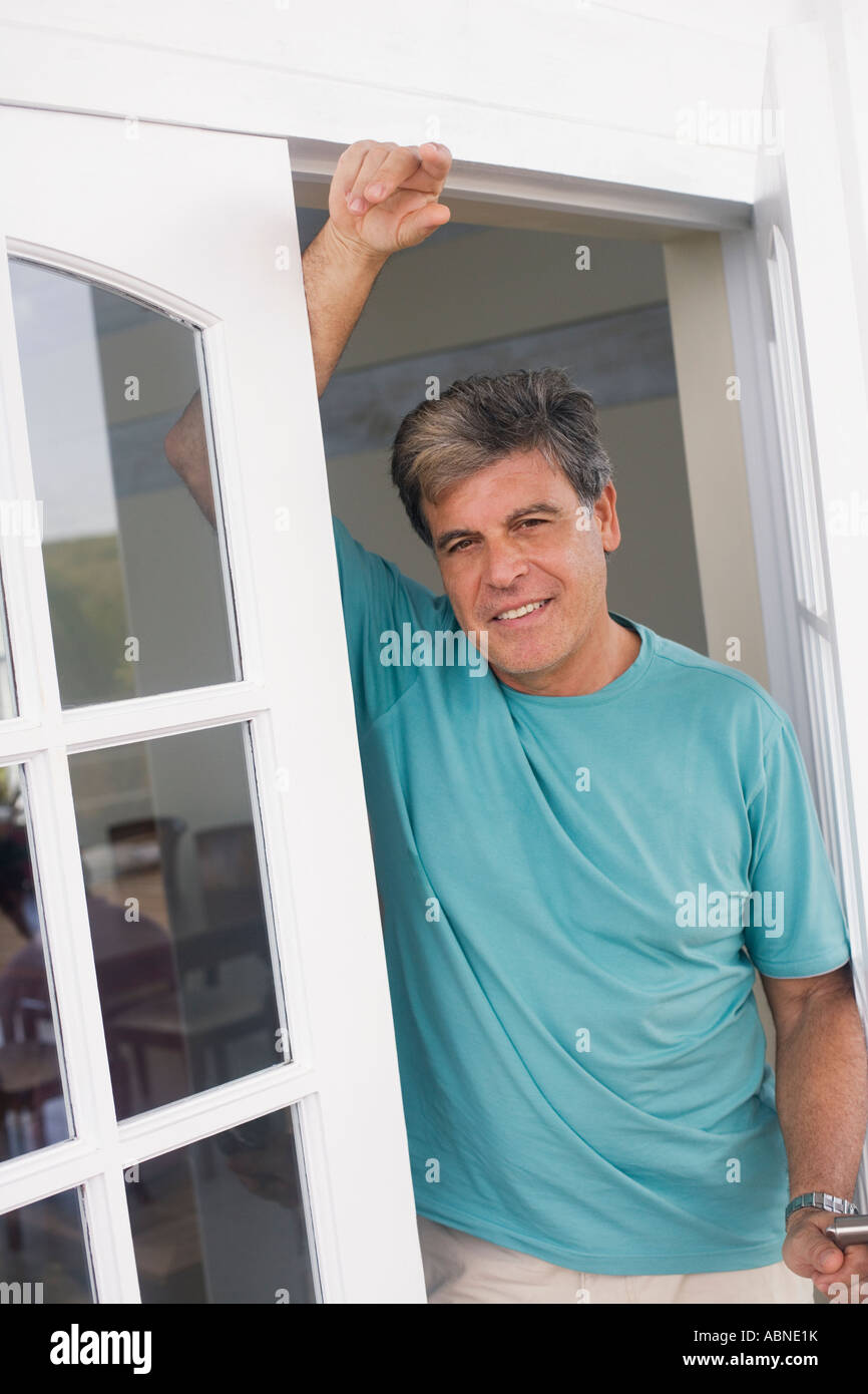 Man Leaning On Doorway Stock Photo 12934446 Alamy