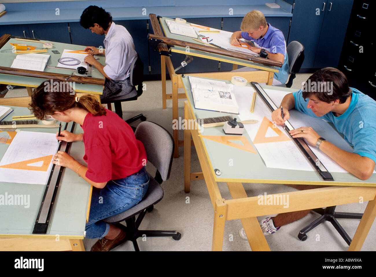 Stock Photo   Students Boys And Girls In High School 11th Grade Drafting  Class With Draft Tables Working In School