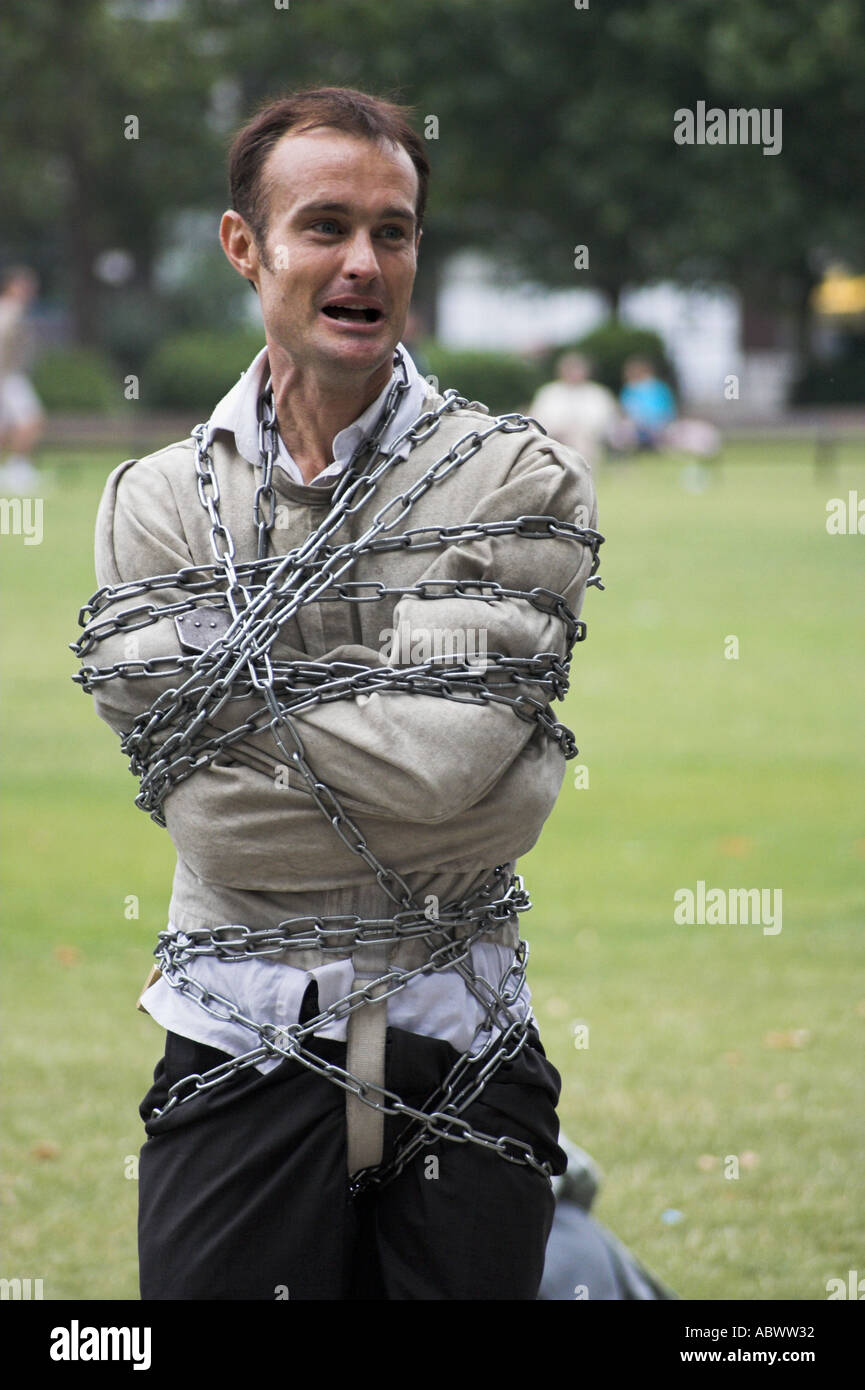 Man in chains and straight jacket Stock Photo, Royalty Free Image ...