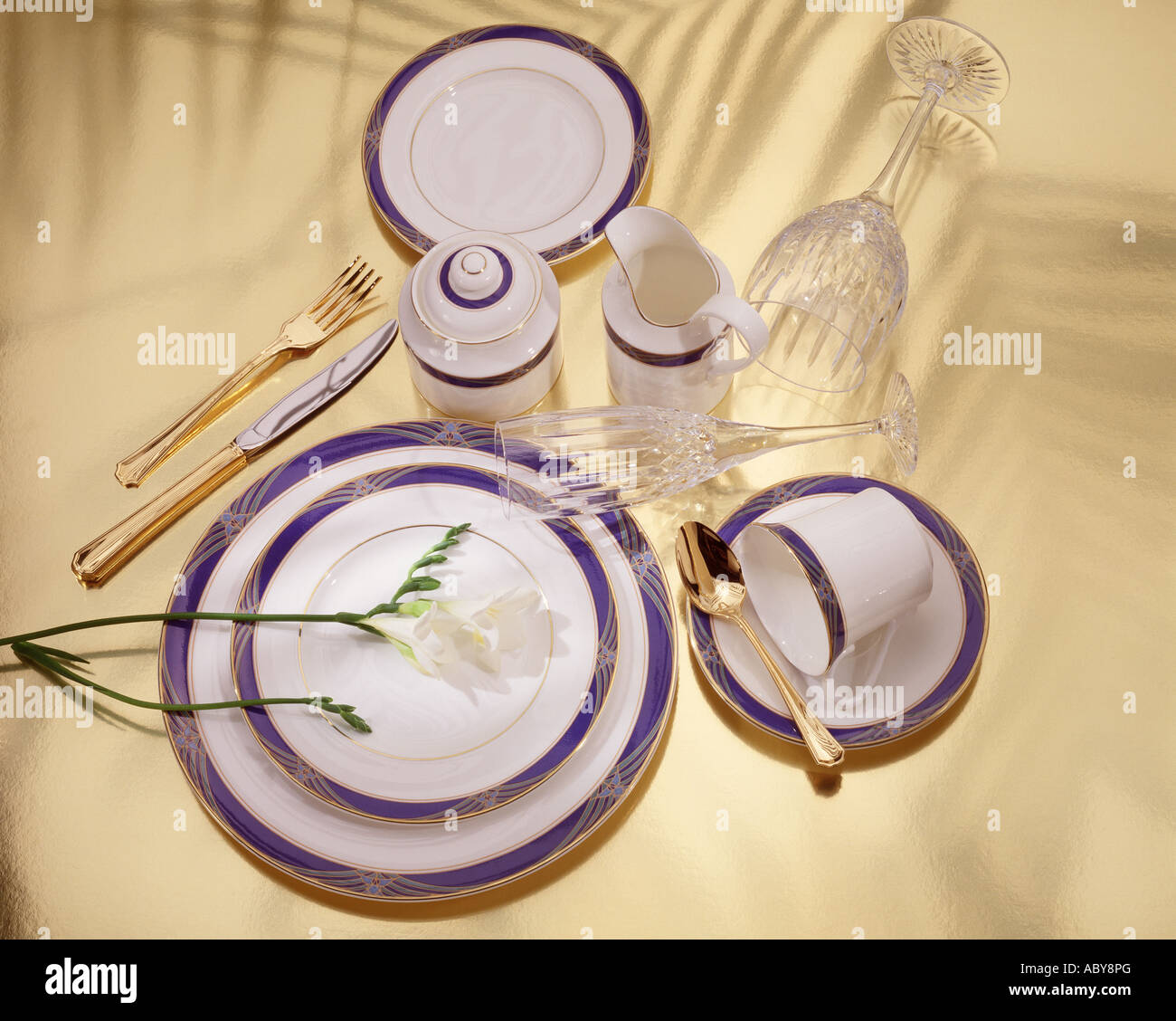 Formal dinner table setting - Stock Photo Formal Dinner Ware Place Table Setting Crystal Goblet Gold Knife Fork Spoon Cup Saucer Sugar Bowl Creamer Plates Holiday