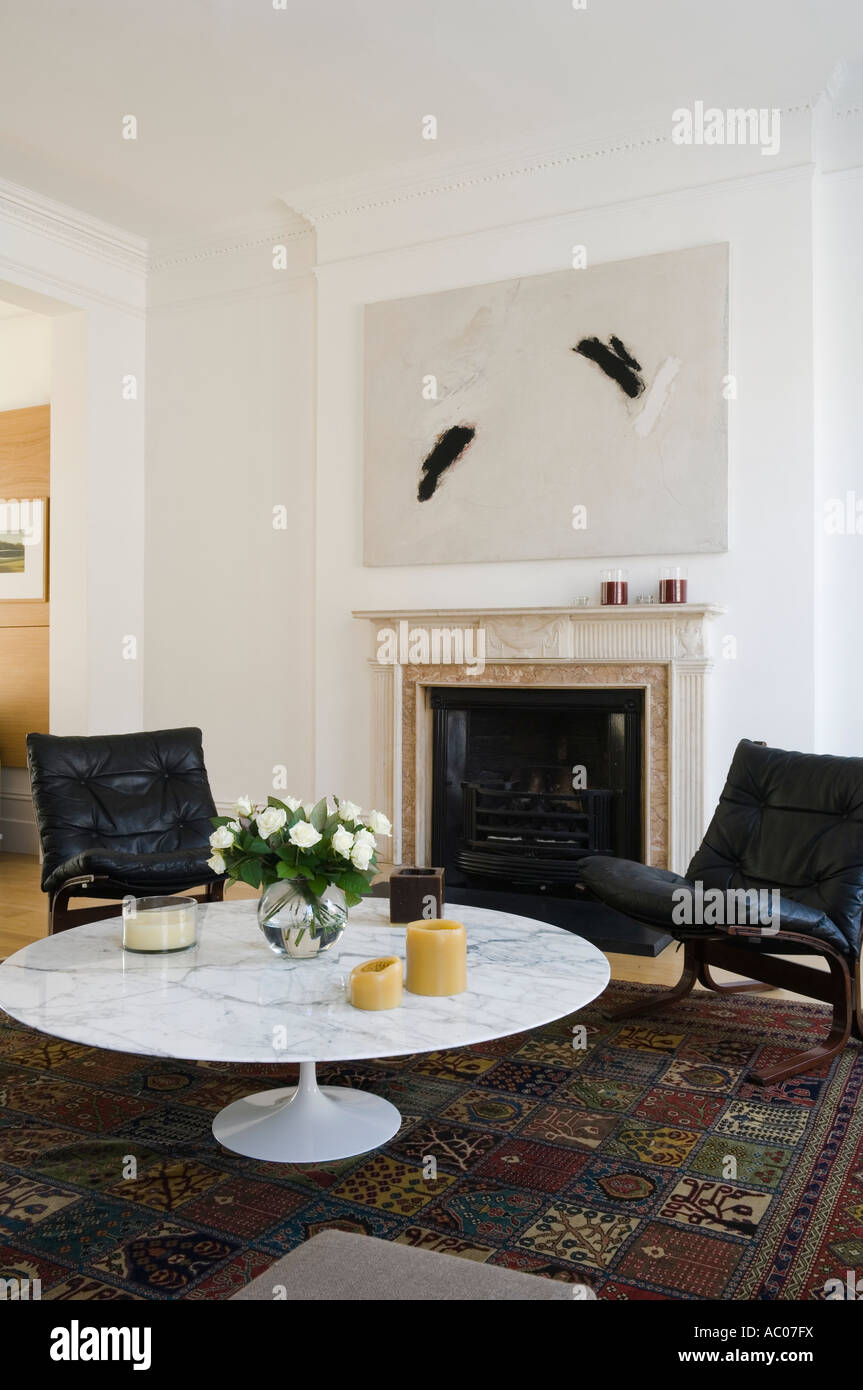 Interior with fireplace and marble topped saarinen coffee table in