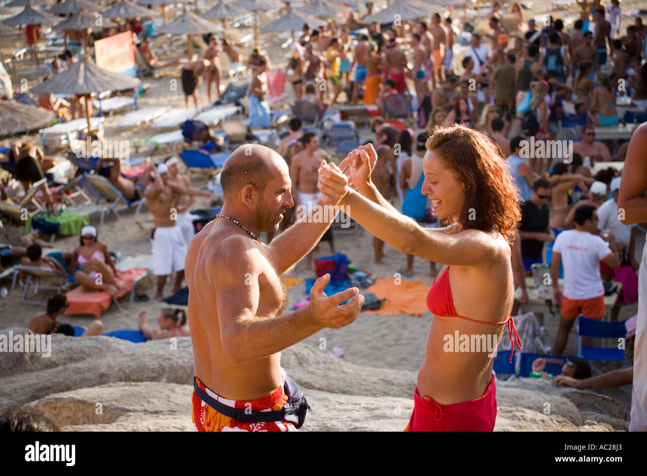 Couple Dancing On A Rock During A Beach Party At Super Paradise Beach Of S And Nudism Psarou Mykonos Greece