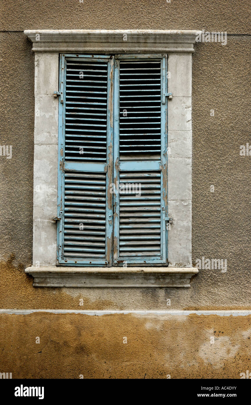 Old shuttered shabby wooden window texture Stock Photo Royalty