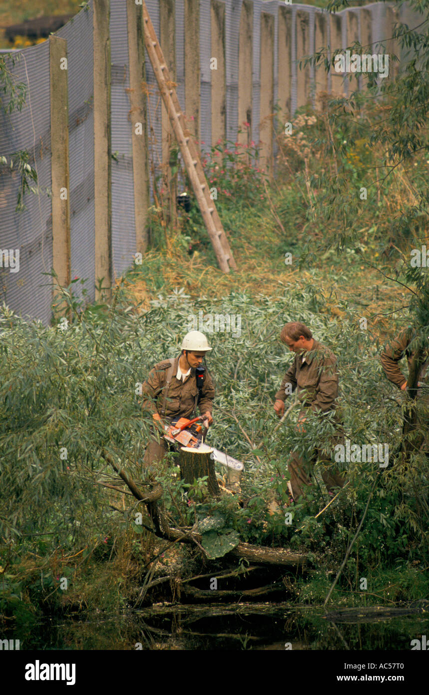 Iron curtain - Iron Curtain East German Border Scouts Felling Trees Under The Fence At Blankenberg 1989 The Fall Of Communism