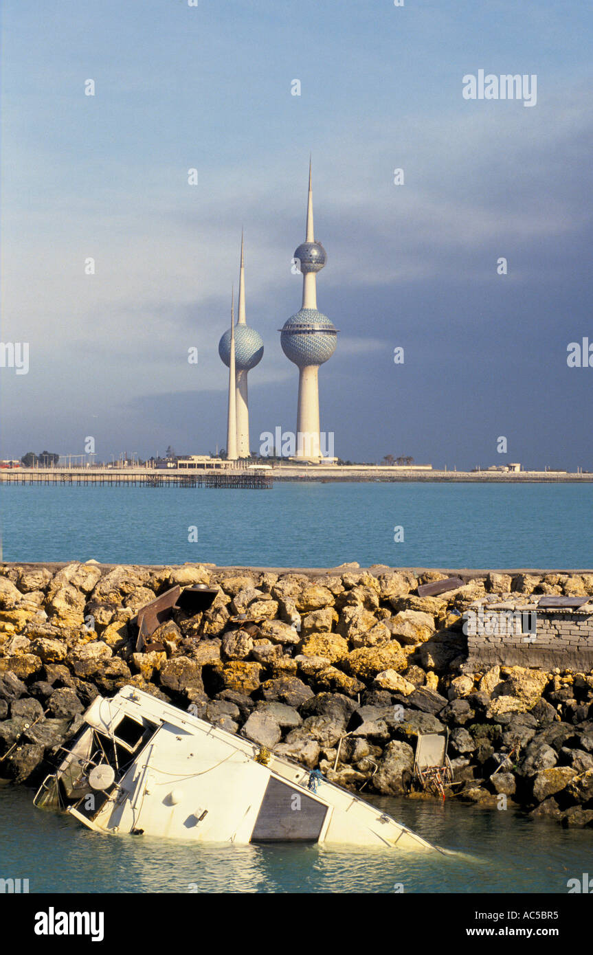 KUWAIT WAR TORN SUNK PLEASURE CRAFT IN FRONT OF KUWAIT TOWERS ...