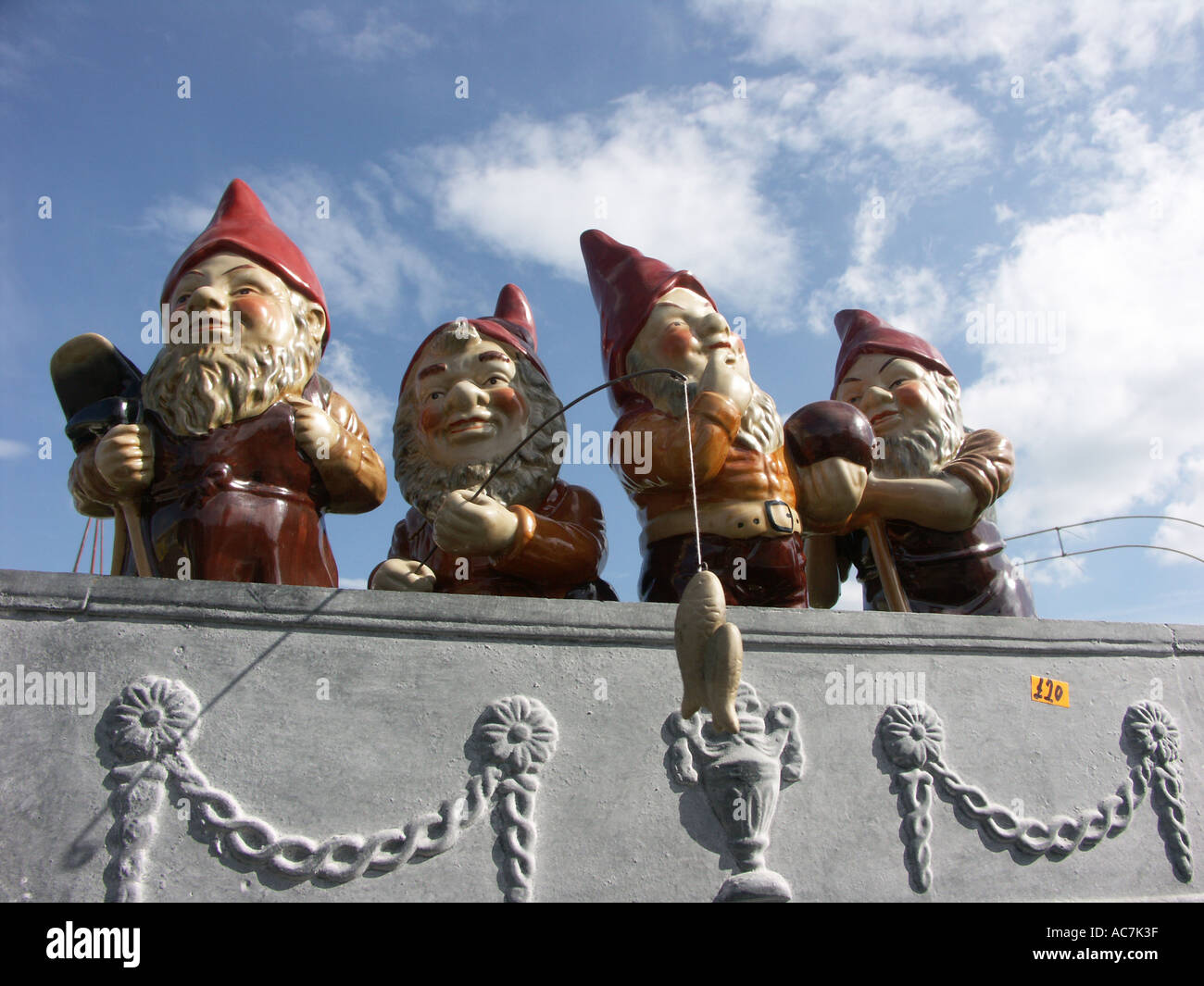 A Stall Selling Outdoor Garden Ornaments Including Gnomes Fishing At The  Malvern Spring Flower Show Worcestershire England