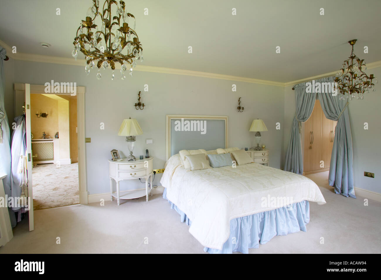 Master bedroom of large home with dressing room and en suite stock photo royalty free image Master bedroom ensuite and dressing room