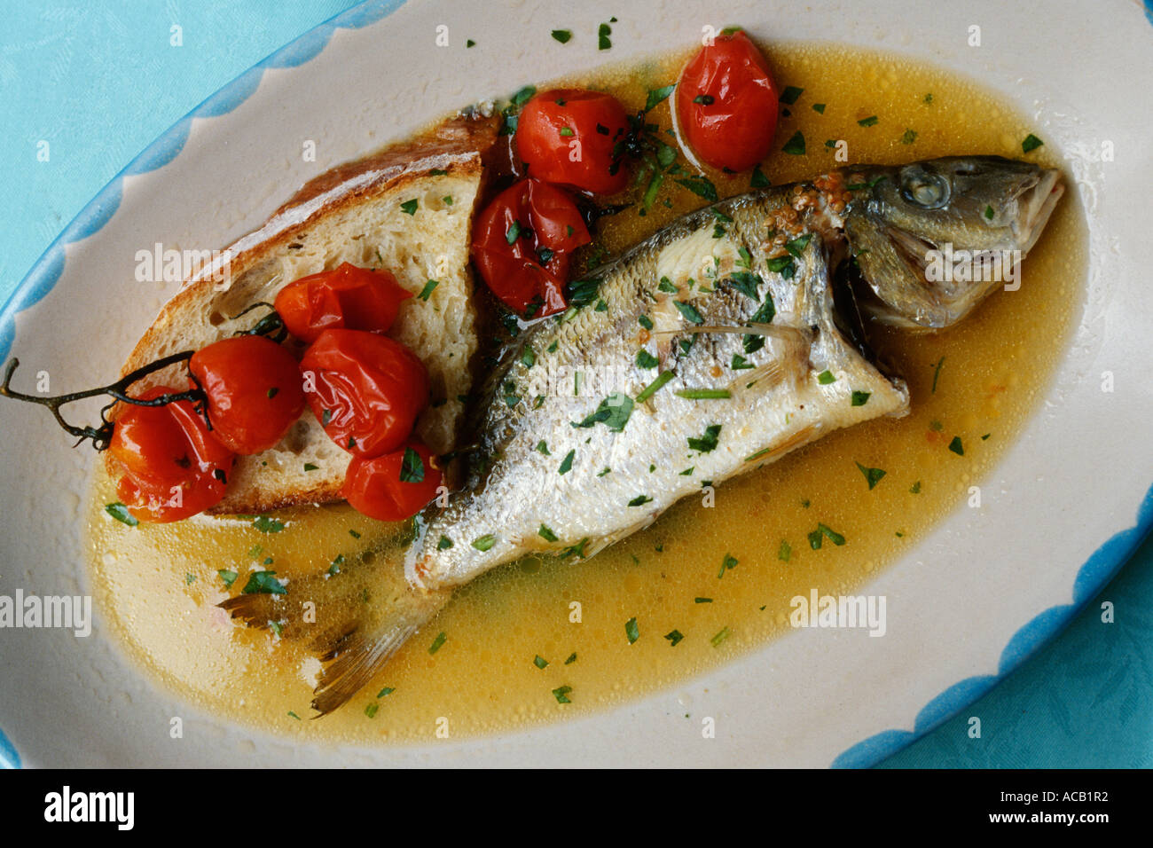 the italian fish dish acqua pazza stock photo royalty