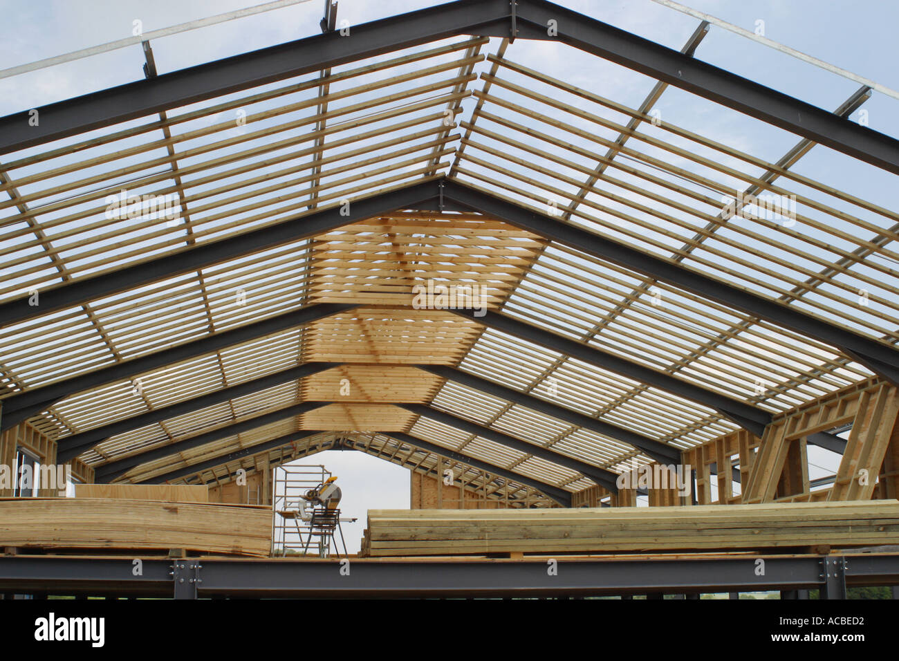 steel frame building under construction showing rib like pattern with timbers stock photo