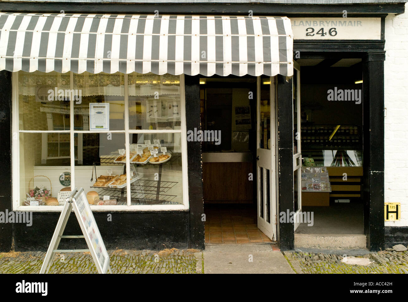Exterior of small independent local bakery shop llanidloes for Small shop exterior design