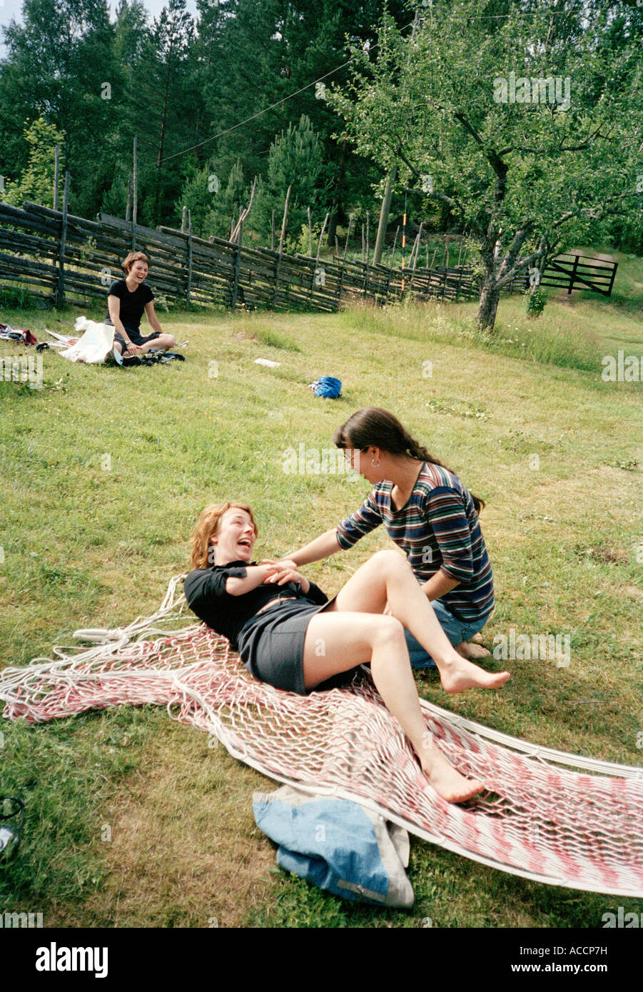 Medium image of two women with a broken hammock