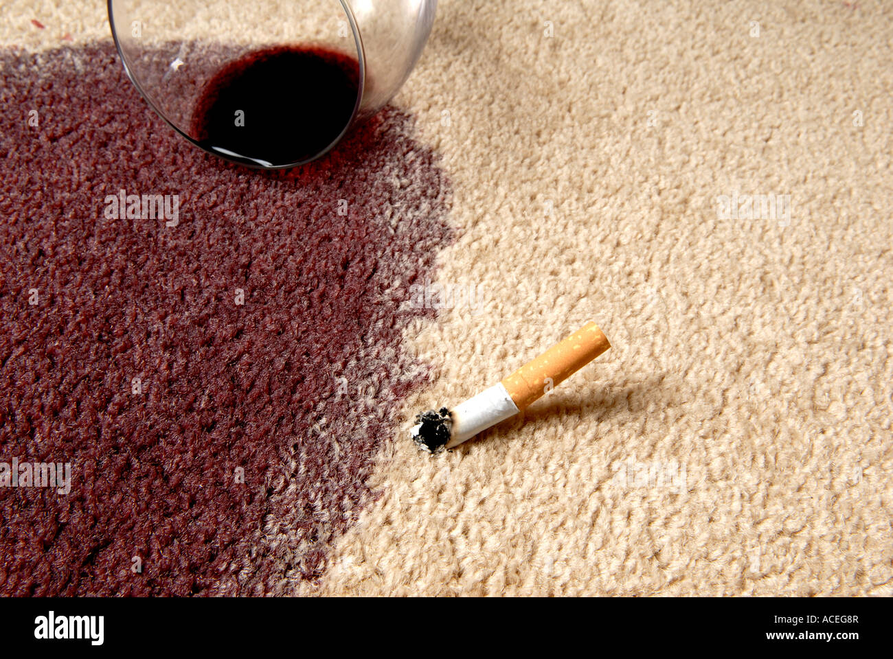 red wine and cigarette on carpet