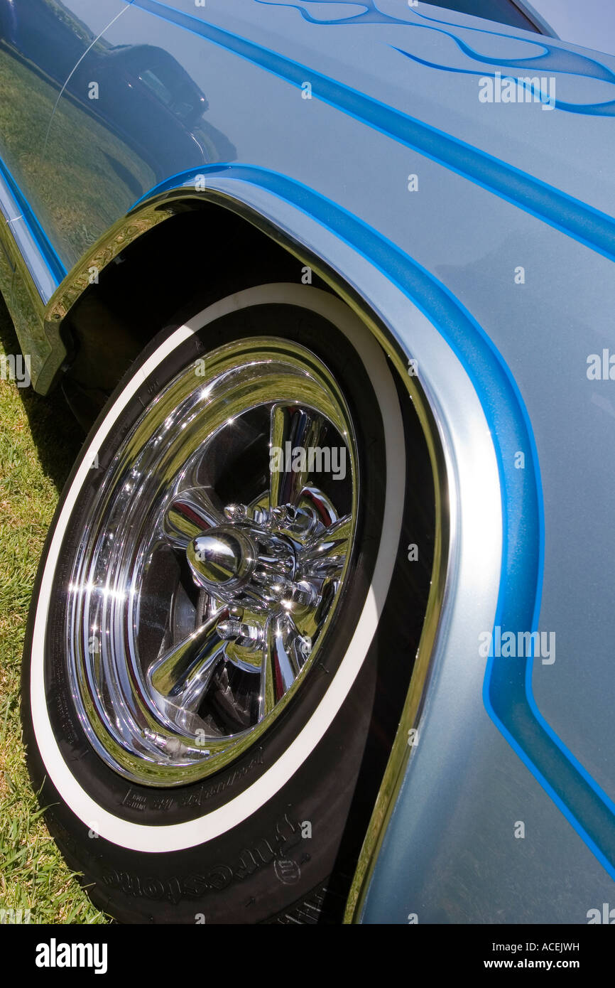 front wheel and white wall tire on a classic blue buick riviera with flames down the side of the car