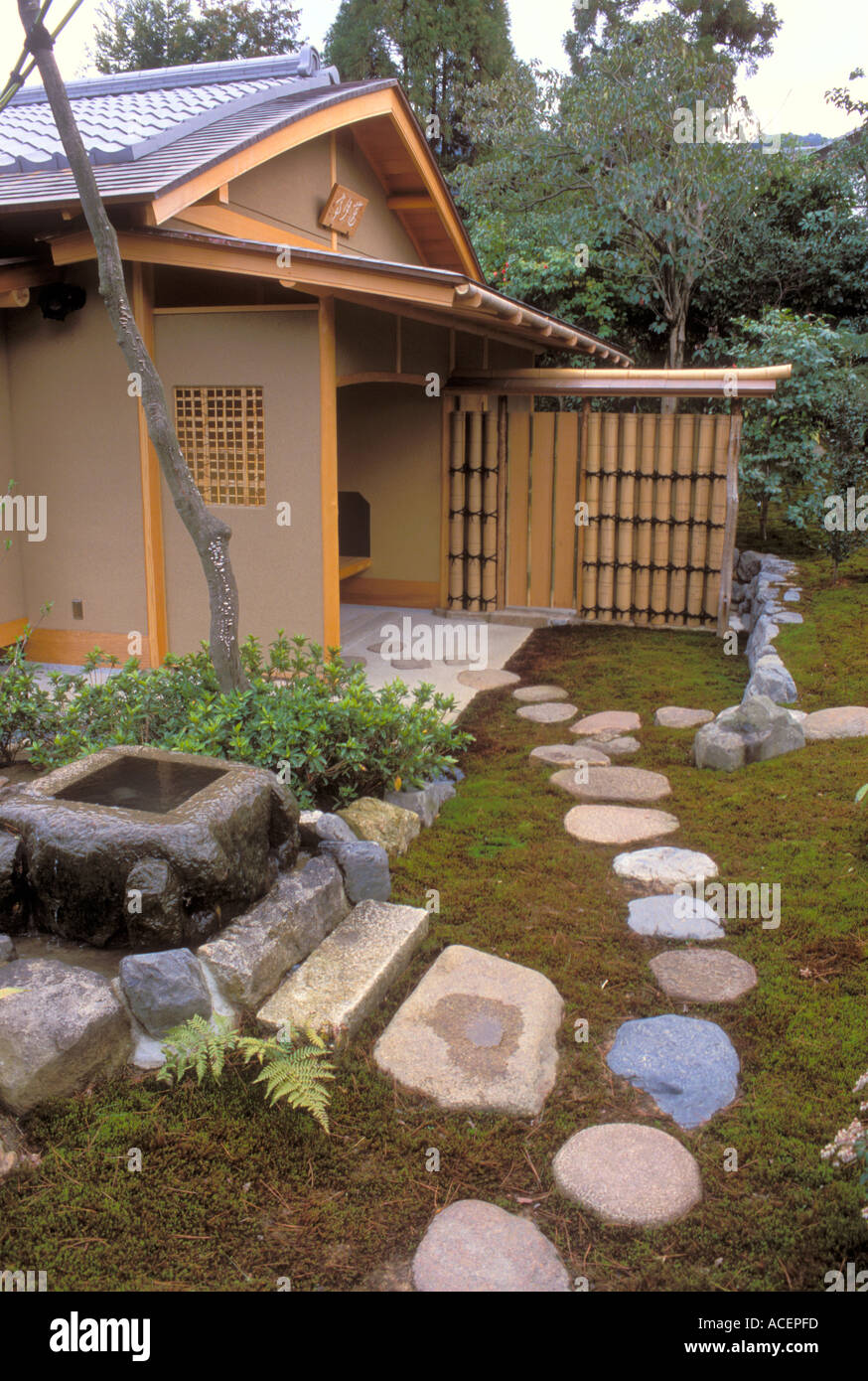 stepping stone pathway leading to a japanese garden tea house
