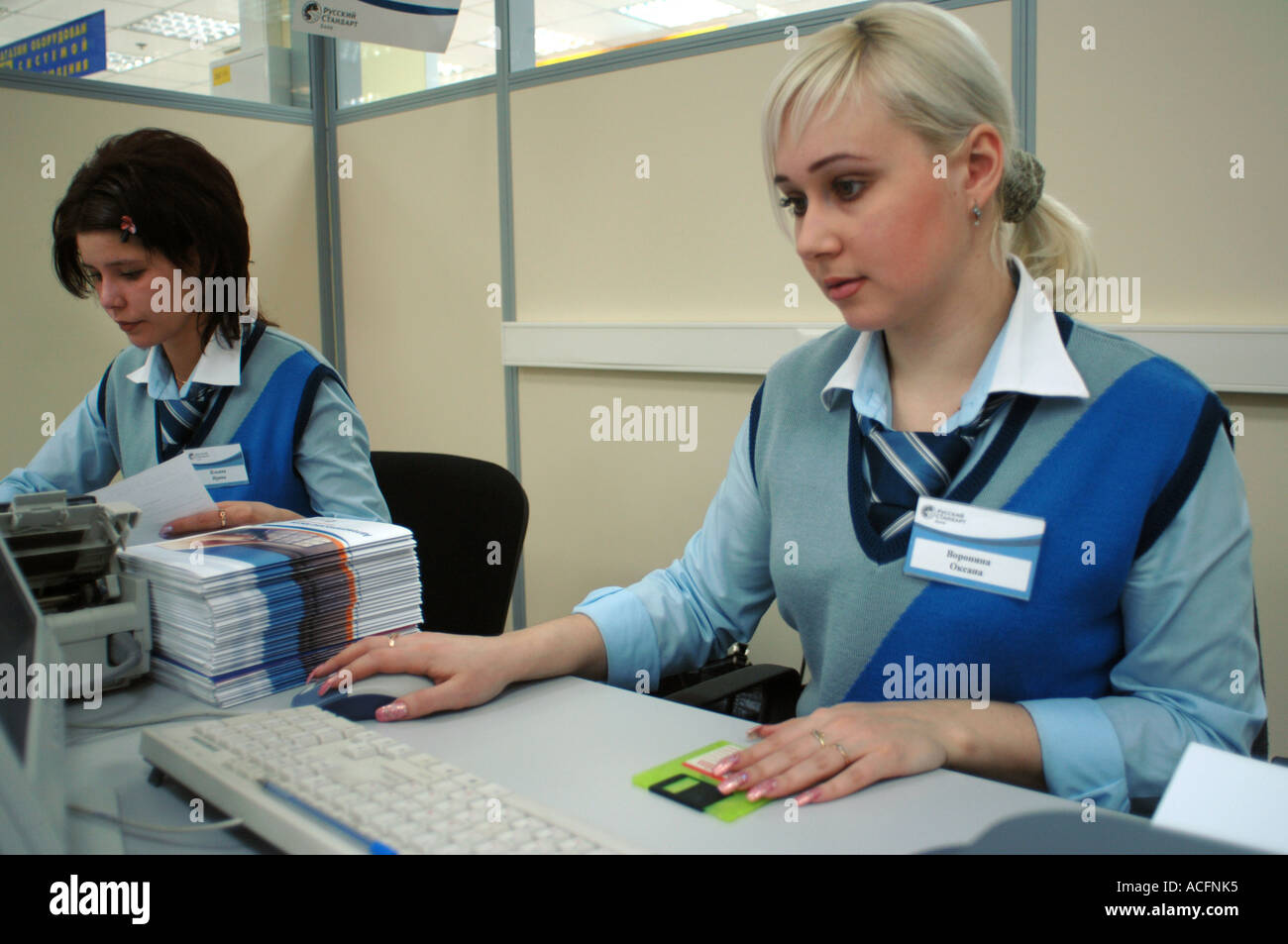 Customer Being Offered Consumer Credit Agreements At Desks By The Check  Outs Of An Electronics Store In Moscow