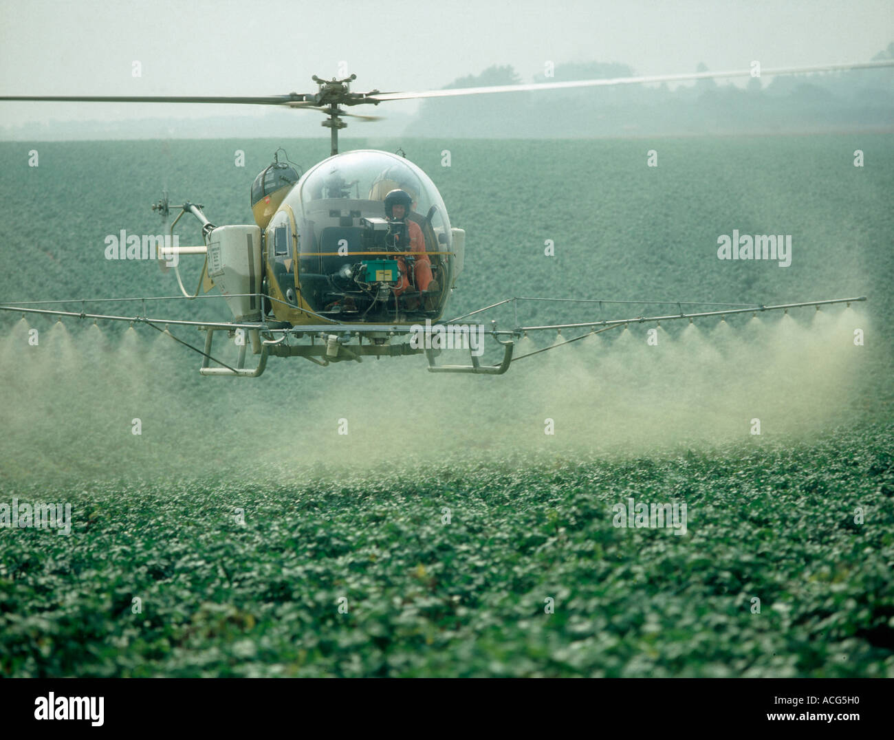 helicopter crop spraying with Stock Photo Helicopter Spraying Maturing Potato Crop With Trace Elements And A 7513039 on New Report Says Global Gmo Crop Cultivation Is Declining Worldwide Most Production  es From Just Six Countries as well Watch additionally Stock Photo Helicopter Spraying Maturing Potato Crop With Trace Elements And A 7513039 also Japan Made Variant Series Helicopter further Stock Photo Retired Old Crop Dusting Helicopter Image30018420.