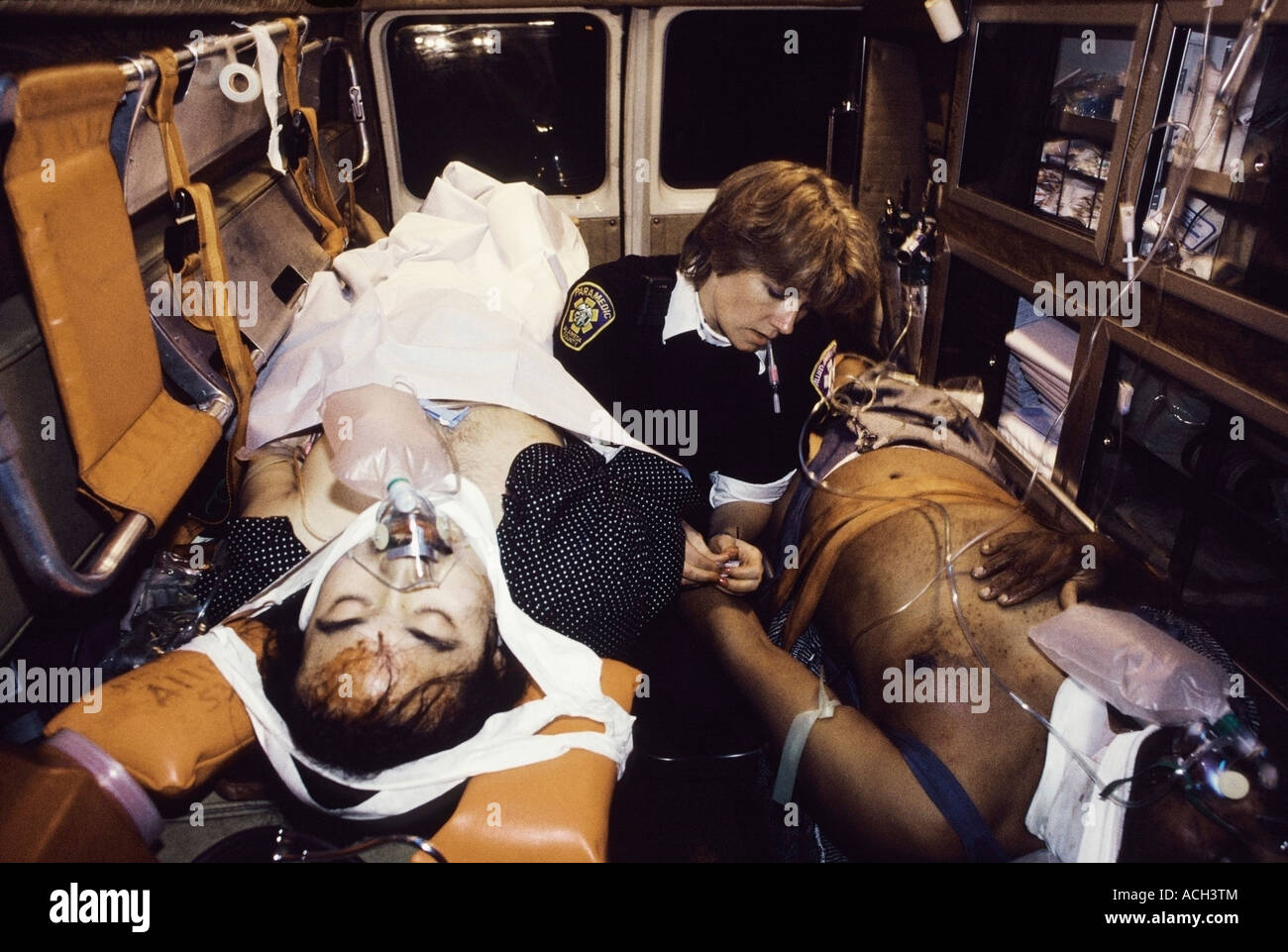 paramedic treats two car accident victims in the ambulance en route to the hospital photo by chuck nacke