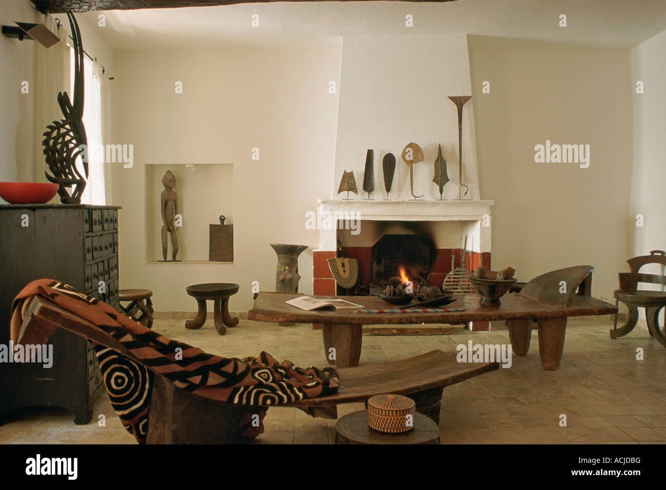 Living Room With African Bibelots And Furniture Coffee Table Cloth On Bench Chimney