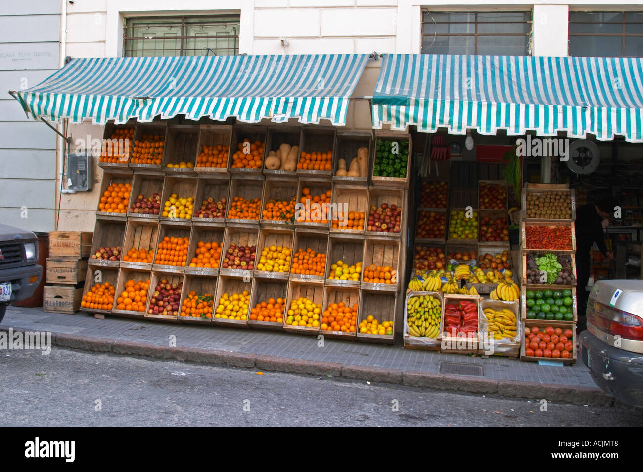 A Fruit And Vegetable Shop Displaying Products In Wooden Crates On The  Street: Tomatoes,