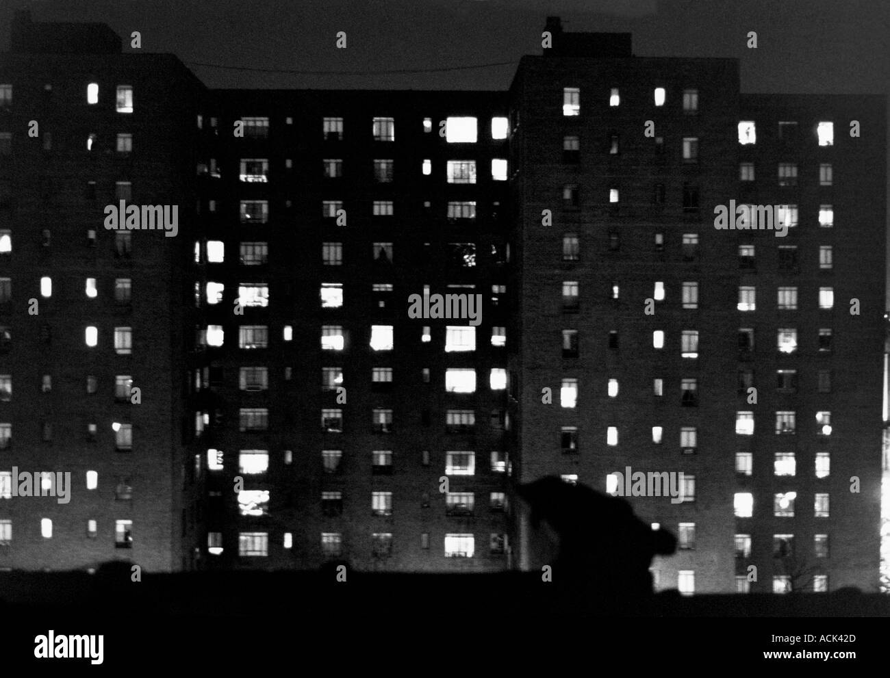 Apartment Building At Night a new york city apartment building at night stock photo, royalty