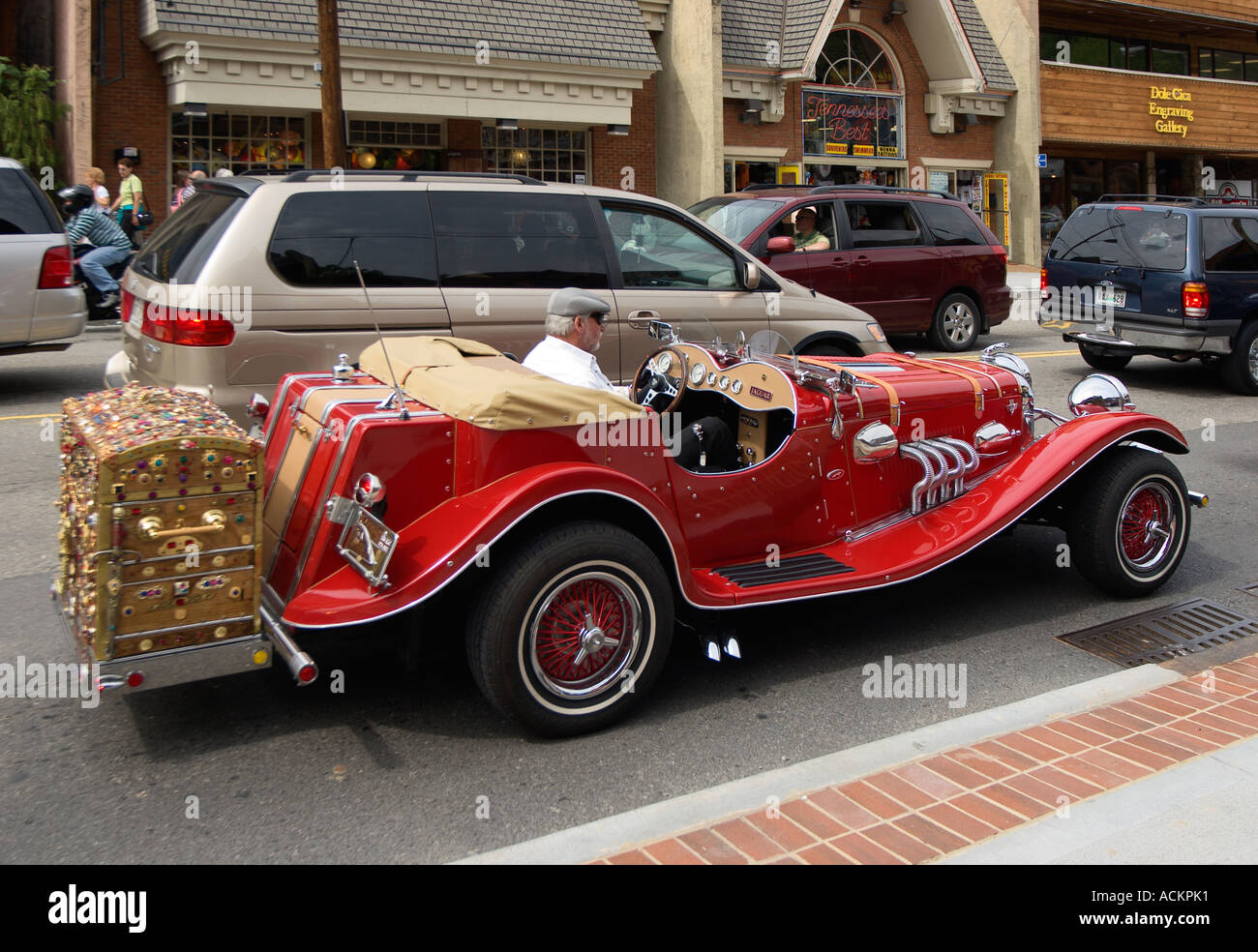 Man shows off bright red jaguar kit car on streets of for Musictown motor cars tennessee