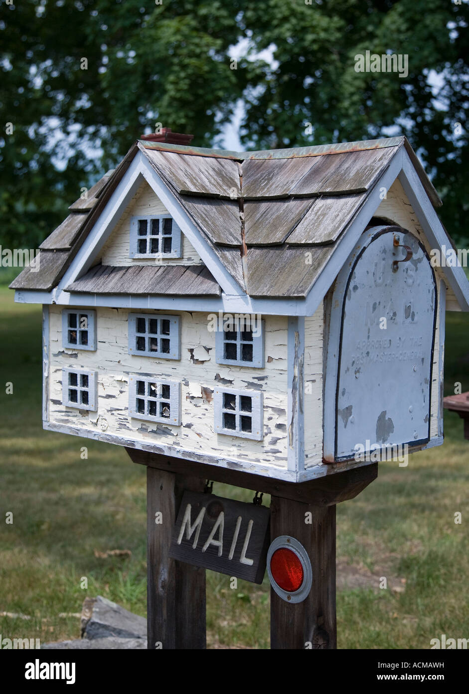 mailbox in the shape of a small house stock photo royalty