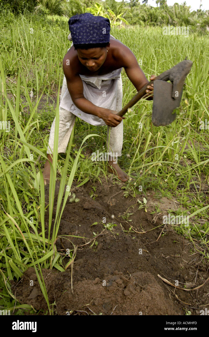 Woman tilling soil with short handled hoe togo west africa for Soil 7t7 woman