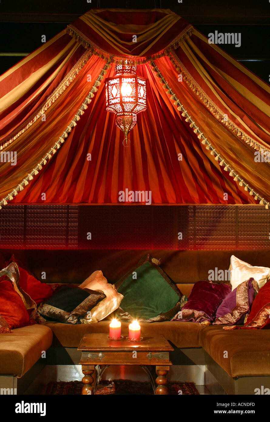 Moroccan tent and furnishings with traditional North African designs including cushions wooden screens and wooden stools  sc 1 st  Alamy & Moroccan tent and furnishings with traditional North African ...